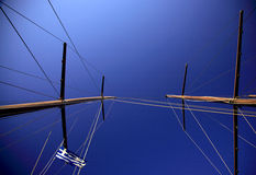 Sailing masts. Vertical view of sailing masts of a greek sailing ship Royalty Free Stock Photography