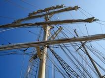 Sailing masts of wooden tallships Stock Photo