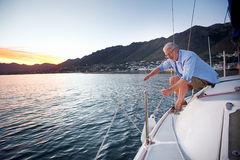 Sailing mature man Stock Photography