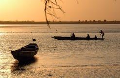 Sailing men. Men sailing in Senegal Royalty Free Stock Photography