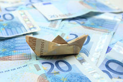 Sailing on money Stock Photo