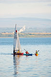 Sailing on Moray Firth. Small yacht and kayaks on the sea in the Moray Firth beside the Black Isle, north east Scotland Stock Images