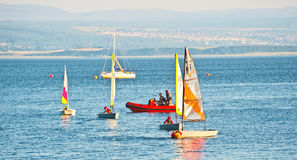 Sailing on Moray Firth. Small yachts and kayak on the sea in the Moray Firth beside the Black Isle, north east Scotland Royalty Free Stock Photo