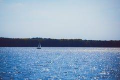 Sailing motor boat on azure lake Royalty Free Stock Images