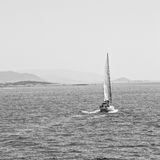sailing  near hill and rocks on the summertime beach in europe g Stock Photos