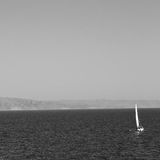 sailing  near hill and rocks on the summertime beach in europe g Royalty Free Stock Photos