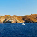 sailing  near hill and rocks on the summertime beach in europe g Royalty Free Stock Image