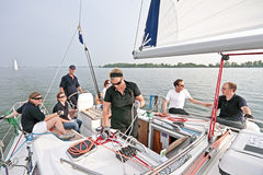 Sailing in the Netherlands at sunset. Sailing on the IJsselmeer at Pampus in the Netherlands with sunset Stock Photos