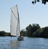 Sailing on the Norfolk Broads. Yacht Sailing on the Norfolk Broads England Royalty Free Stock Image