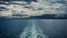 Sailing on the ocean with dramatic sky stock footage