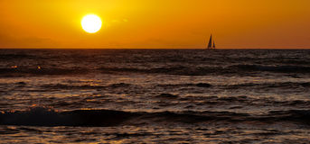 Sailing on the ocean at sunset Royalty Free Stock Photography
