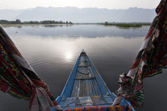 Sailing over Dal lake in Kashmir with colorful boat Stock Photos