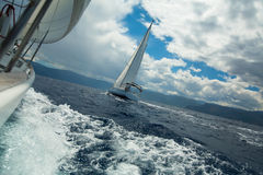 Sailing over the ocean waves in stormy weather. Nature. Stock Images