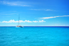 Sailing party catamaran in the blue carribean sea and cloudscape Royalty Free Stock Images
