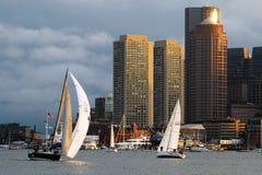 Sailing past the Boston Skyline. Sailboats glide through Boston Harbor stock images