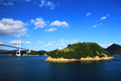 Sailing past Japanese Islands. Sailing past a bridge and islands in Japanese waters Stock Images