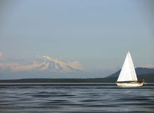 Sailing Past Mount Baker. Having a fun summer sail in the southern Gulf Islands of British Columbia, with Mount Baker in Washington State in the background Stock Photos