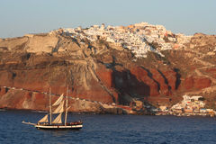 Sailing past Santorini. Royalty Free Stock Images