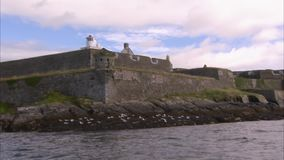 Sailing past a castle. A sailing past shot of a castle in Ireland stock video
