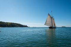 Sailing on the Penobscot Bay. A sailboat glides over the calm waters of the Penobscot Bay on a summer day Stock Photo