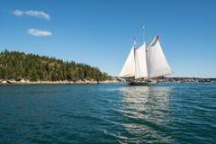 Sailing on the Penobscot Bay. A sailboat glides over the calm waters of the Penobscot Bay on a summer day Royalty Free Stock Photos