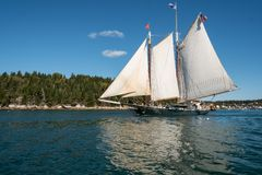 Sailing on the Penobscot Bay. A sailboat glides over the calm waters of the Penobscot Bay on a summer day Stock Image