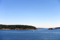 Sailing. Picture of a sailing boat,taken from a ferry on the way to Salt Spring Island,BC,Canada Stock Image