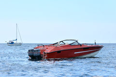 Sailing and power boat. On the open sea royalty free stock photography