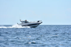 Sailing and power boat Stock Photo
