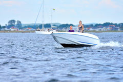 Sailing and power boat. On the open sea stock photo