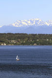 Sailing on Puget Sound with Olympic Peninsula View. Sailboat on Puget Sound with Olympic Peninsula Mountain Range Royalty Free Stock Images