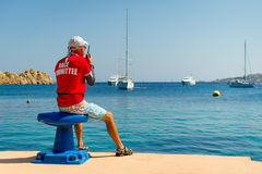 Sailing race referee watching at the yachts in beautiful bay Royalty Free Stock Photos