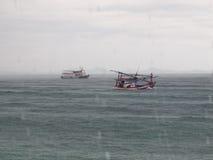 Sailing in the rain. Fishing boats still sail in the rain Stock Photography