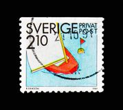 Sailing, Rebate stamps - Summer Activities serie, circa 1989. MOSCOW, RUSSIA - AUGUST 18, 2018: A stamp printed in Sweden shows Sailing, Rebate stamps - Summer stock photo