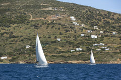 Sailing regatta at Aegean off the coast the Greek islands. Royalty Free Stock Photos