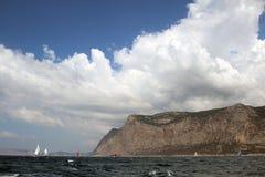 Sailing regatta along the coast Royalty Free Stock Images