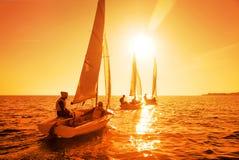 Sailing Regatta. Beautiful view of sailing yachts at sunset Royalty Free Stock Photo