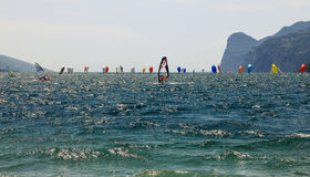 Sailing regatta with plenty of boats and beautiful colored sails. The competing sailing boats have windfilled sails and try to overtake each other. Some Stock Images