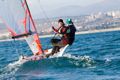 Sailing Regatta. Team of two girls deftly managed to sail in the sea Stock Image