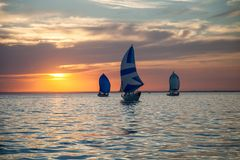 Sailing reggata. Finish regatta at sunset on the river open spaces stock photo
