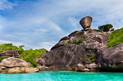 Sailing Rock, clear sea and blue sky on the island of Koh Similan, the group Similan Islands, Andaman sea, Thailand. Sailing Rock, clear sea and blue sky on the stock photo