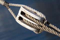 Sailing rope tension with the fishing pulley.  Royalty Free Stock Photography
