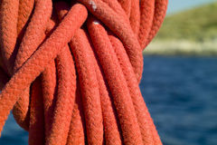 Sailing ropes. With blue sea in the background Stock Photo