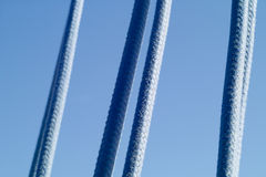 Sailing ropes. With blue sea in the background Stock Photography