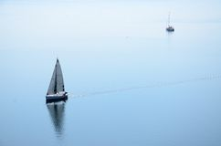 Sailing. Sailboats on a peaceful lake Stock Image