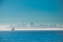 Sailing on San Francisco Bay. Yacht sailing on San Francisco Bay with the city skyline behind Royalty Free Stock Photography