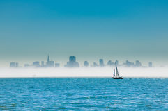 Sailing on San Francisco Bay. Yacht sailing on San Francisco Bay with the city skyline behind Stock Photo