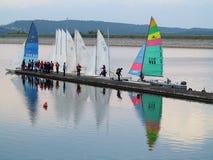 Sailing school at lake. People at the jetty of a lake preparing their sailing boats. At lake Brombachsee, Germany stock photo