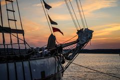 Sailing schooner at sunset Stock Images
