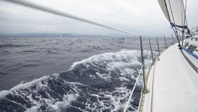 Sailing in the sea during deteriorating weather (cloudy weather). Cruise luxury yacht. Royalty Free Stock Image